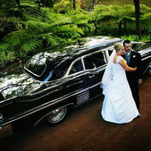 Couple With Classic Cadillac For Hire